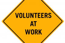 Volunteers At Work sign