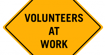 Volunteers At Work sign